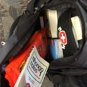 Several books and Reese's Cups with which to buy Japanese friends