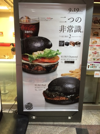 This atrocity is Burger King's limited-time only black burger. The black is mostly food coloring but the cheese has squid ink in it. Try one today! hlgrk...